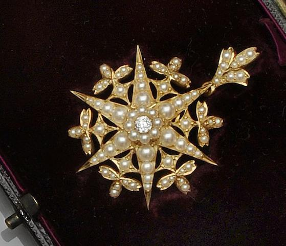 A late Victorian gold half pearl and diamond snowflake brooch