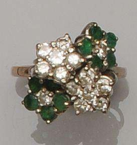 A multi-cluster emerald and diamond ring