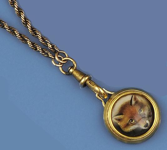 An enamelled fox mask pendant and chain and a silver mounted shell snuff bottle (2)