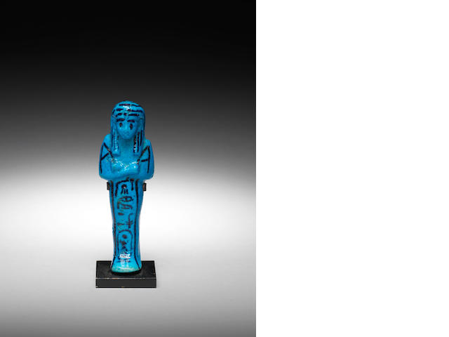 An Egyptian bright blue glazed composition shabti of King Pinedjem I