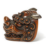 A rare boxwood netsuke of a shishi mask  By Kokushosai, 19th century