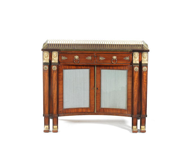 A Regency mahogany, ebony and brass inlaid breakfront secretaire side cabinet