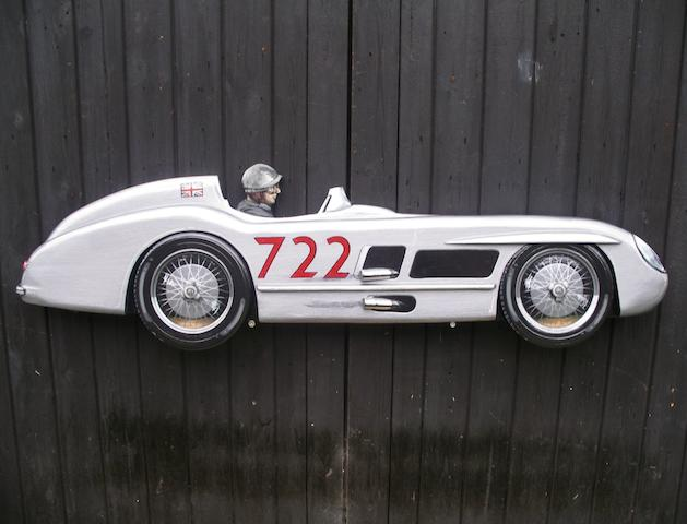 A hand-painted wooden profile of Stirling Moss's Mille Miglia Mercedes 300 SLR,