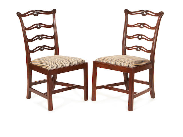 A set of six 19th century mahogany ladderback dining chairs in the George III style