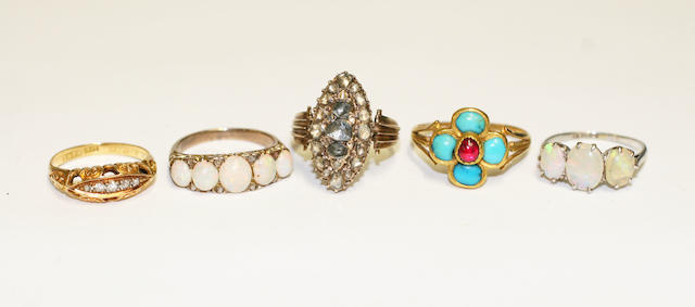 Five gem set rings,