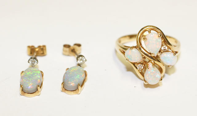 An opal and diamond dress ring, (3)