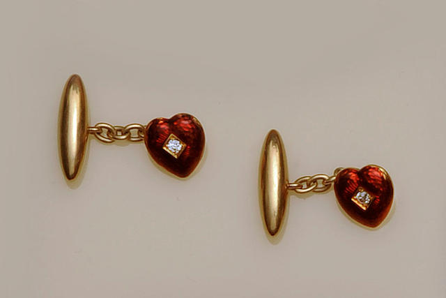 A pair of enamel and diamond cufflinks