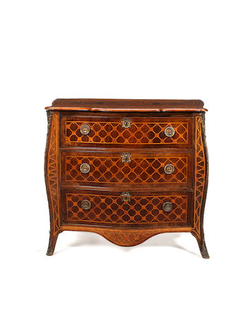 A Dutch 18th century rosewood, mahogany and fruitwood bombé commode