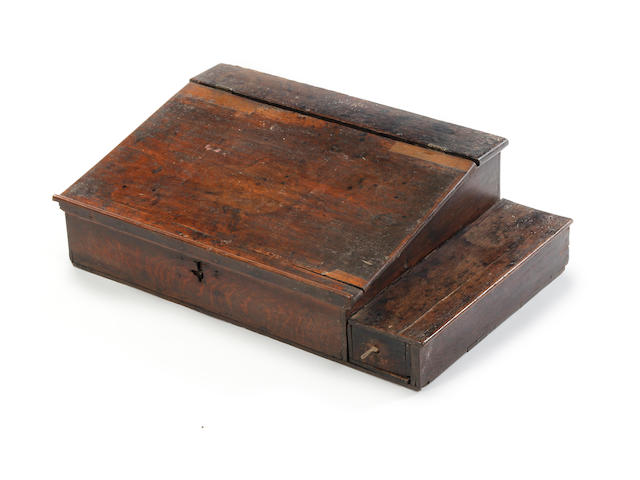 An oak boarded desk box with side till Circa 1700