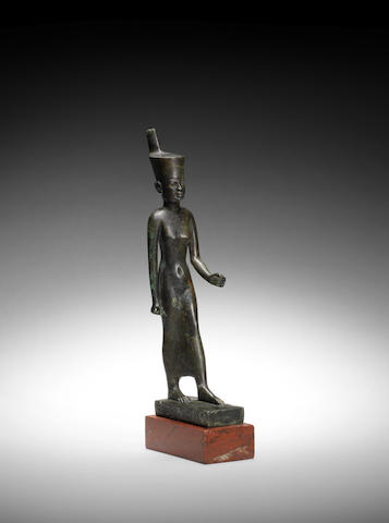 An Egyptian bronze figure of Neith