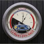 A 'Jaguar at Le Mans' themed garage clock,
