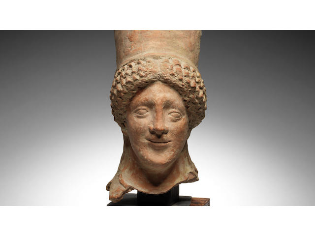 A Greek terracotta head of a kore