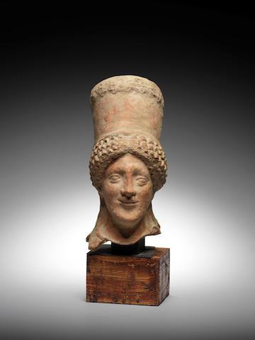 A Greek terracotta head of a kore