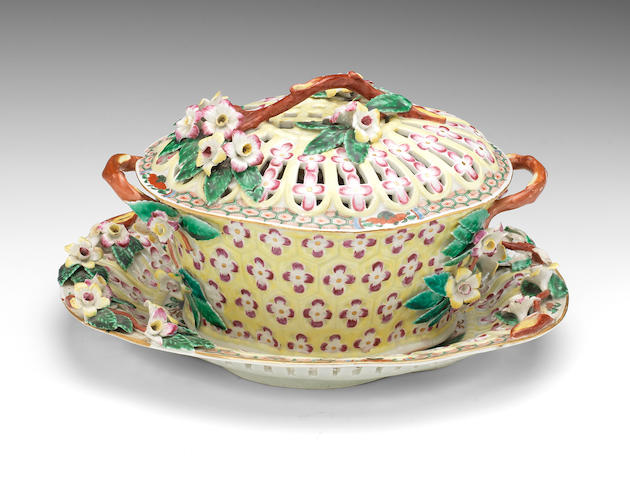A Worcester yellow ground chestnut basket, cover and stand, circa 1768-70