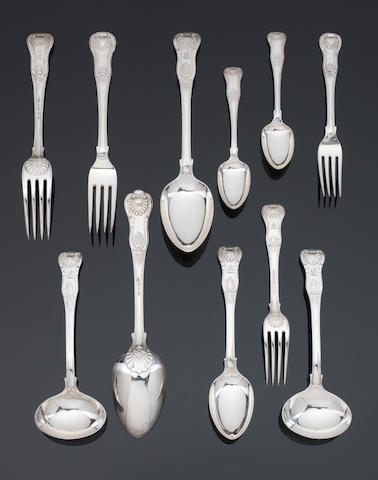 A matched silver King's pattern table service of flatware predominately by Savory, London 1824 - 1835