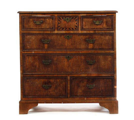 An unusual George II figured oak, fruitwood and yew inlaid chest of drawers, named and dated