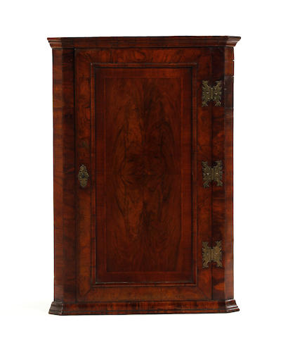A George II walnut mural corner cupboard