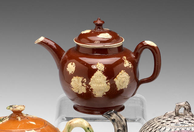 A Staffordshire glazed red earthenware teapot and cover, circa 1750