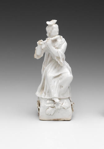 A very interesting English white figure of a lady musician, circa 1750-52