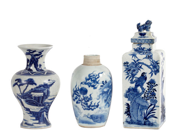 A Chinese blue and white vase, a tea canister and cover and an ovoid vase