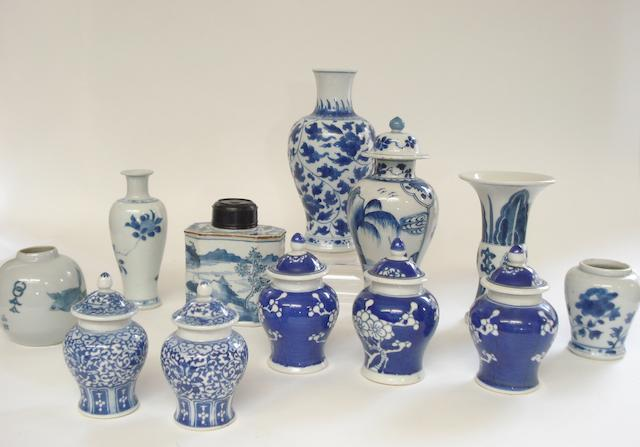 A tea caddy together with a group of small blue and white items 19th century and later