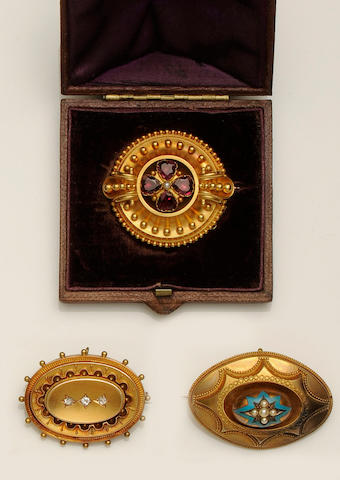 A Victorian gold circular garnet set brooch (3)