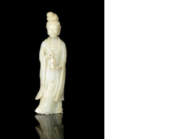 A pale green jade figure of a lady Immortal Late 18th/19th century
