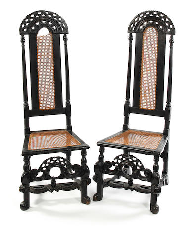 A pair of William & Mary ebonised beech high-back side chairs