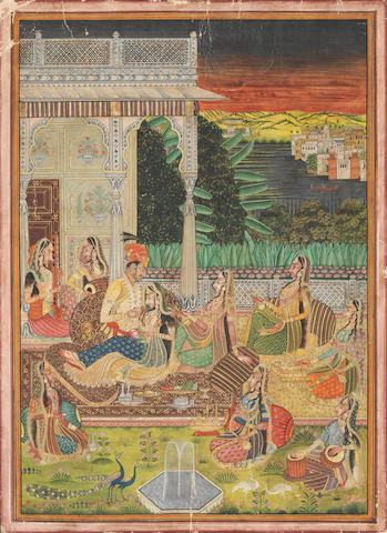 A prince seated on a terrace with maidens and female musicians, a lake and an extensive landscape beyond Kishangarh, circa 1920-1930