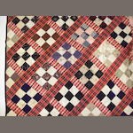 An early 20th century patchwok quilt