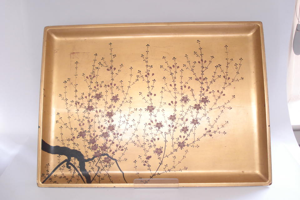 A carved and lacquered tray and three others Circa 1920s