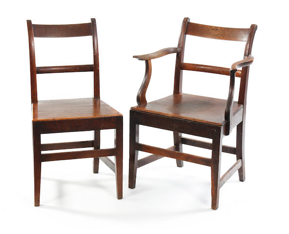 A set of seven George III oak dining chairs