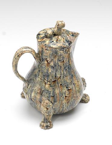A Staffordshire lead-glazed agateware jug and cover, circa 1755