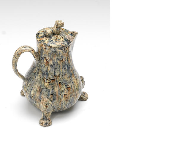 A Staffordshire lead-glazed agateware jug and cover, circa 1755