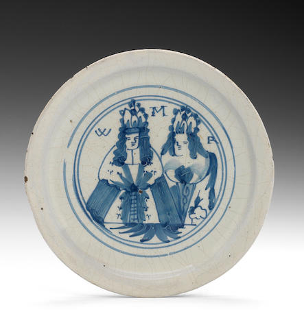 A London delftware royal portrait plate of William and Mary, painted with half length portraits (minor chips)
