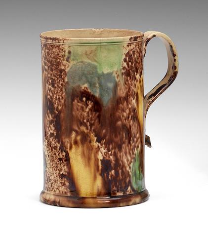 A Staffordshire mug of Whieldon type, circa 1760-65