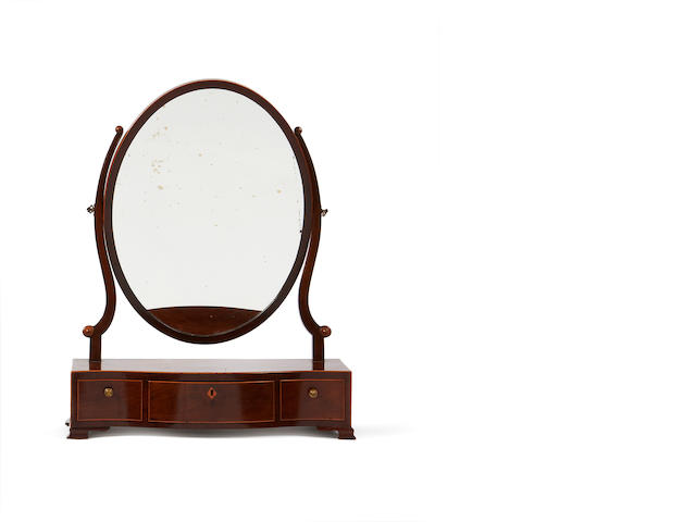 A George III mahogany serpentine toilet mirror