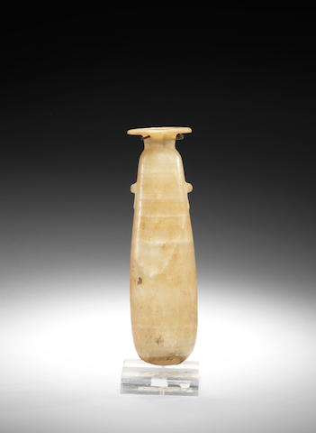 An Egyptian alabaster alabastron