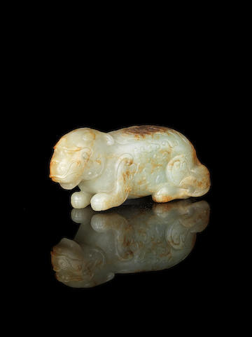 A pale green and russet jade carving of a bixie Ming Dynasty