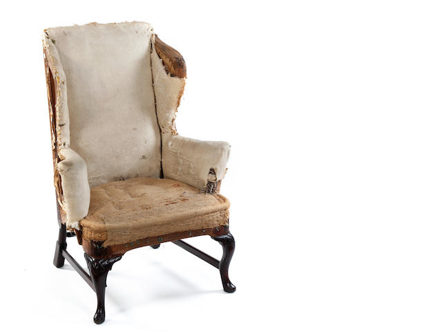 A George II mahogany wing chair Lacking upholstery