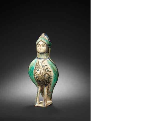 A large intact moulded pottery pouring Vessel in the form of a Harpy Kashan, Iran, 1150-1200AD