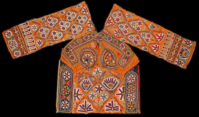 An Indian embroidered and applique childs tunic