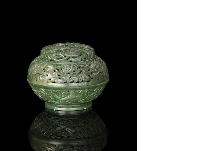 A spinach-green jade reticulated perfumier and cover, 19th century