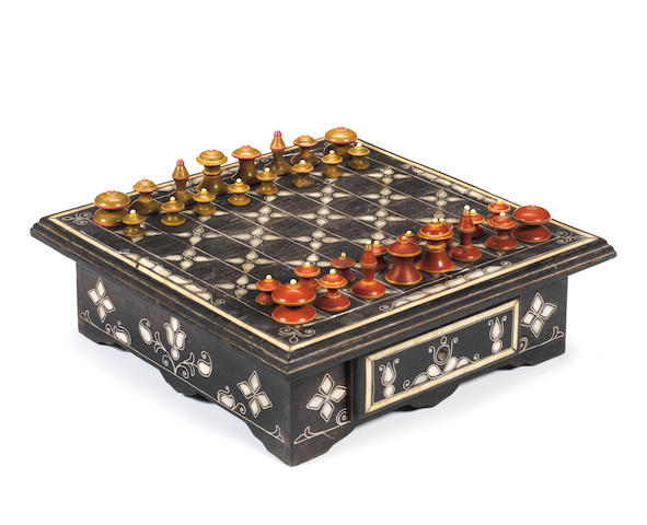 An Islamic wooden and bone mounted chess set with board, Northern India, circa 1900,