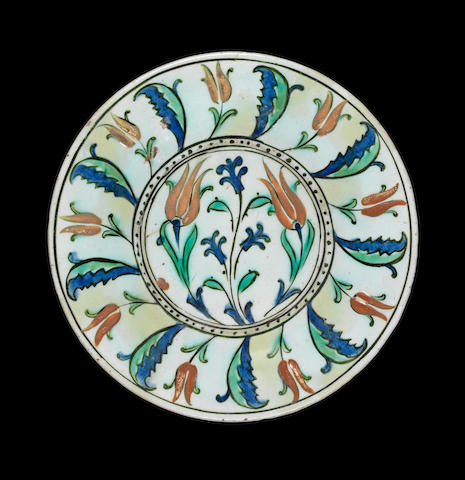 An Iznik polychrome and gilt decorated pottery Dish Turkey, mid-17th Century