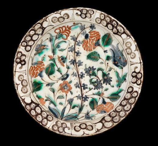 An Iznik 'Storm in a teacup' design pottery Dish Turkey, 17th Century