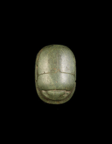 An Egyptian green schist heart scarab