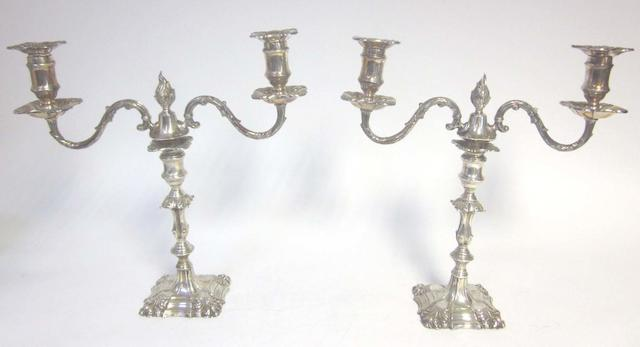 A pair of silver candelabra with associated electroplated detachable branch sections, in the 18th century manner, candlesticks by Thomas Bradbury & Sons Ltd, unmarked branch sections, Sheffield 1900,
