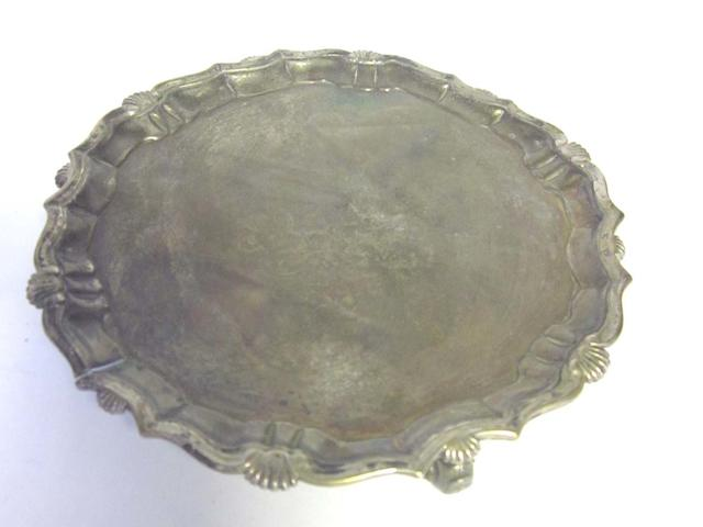 A George II silver salver, maker's mark distorted,  London 1738, a George III drum mustard pot, London 1819, a William IV cream jug, by George Frederick Pinnell, London 1832,   together with two silver napkin rings, by Martin Hall & Co, Sheffield 1907 (5)