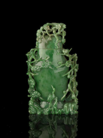 A spinach-green jade vase and cover Late Qing Dynasty